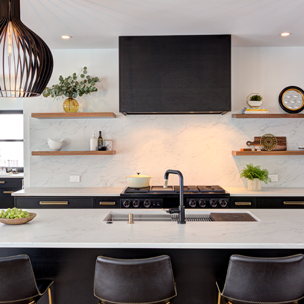 photo of a luxurious local home in maine with a marble countertop and matching stone backsplash